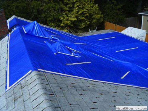 After - Cut holes in main tarp; apply small tarps over tall roof vents