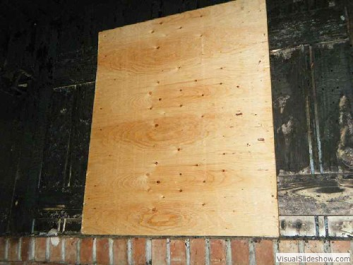 Exterior After - Security screws used to attach plywood to exterior of house